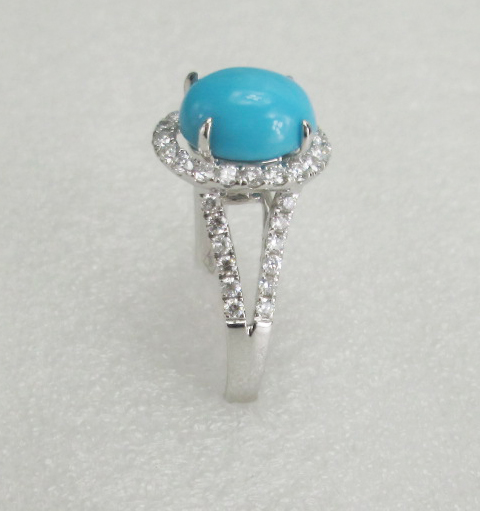 18 K White Gold Ring With real diamond and turquoise stone